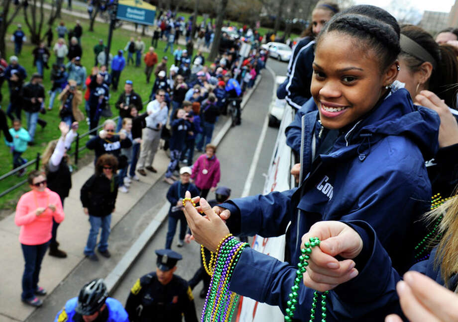 Connecticut's Moriah Jefferson throws beads to fans during a parade celebrating the women's basketball team's national championship victory in the NCAA college tournament in Hartford, Conn., Sunday, April 14, 2013. (AP Photo/Jessica Hill) / FR125654 AP