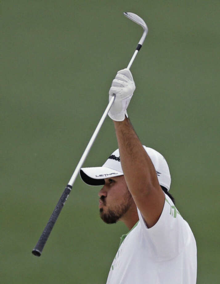 Jason Day, of Australia, celebrates after chipping in for an eagle on the second hole during the fourth round of the Masters golf tournament Sunday, April 14, 2013, in Augusta, Ga. (AP Photo/David Goldman)