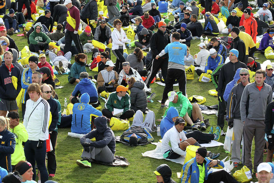 Runners gather at the athletes village prior to the start of the 117th running of the Boston Marathon, in Hopkinton, Mass., Monday, April 15, 2013. (AP Photo/Stew Milne) / FR56276 AP