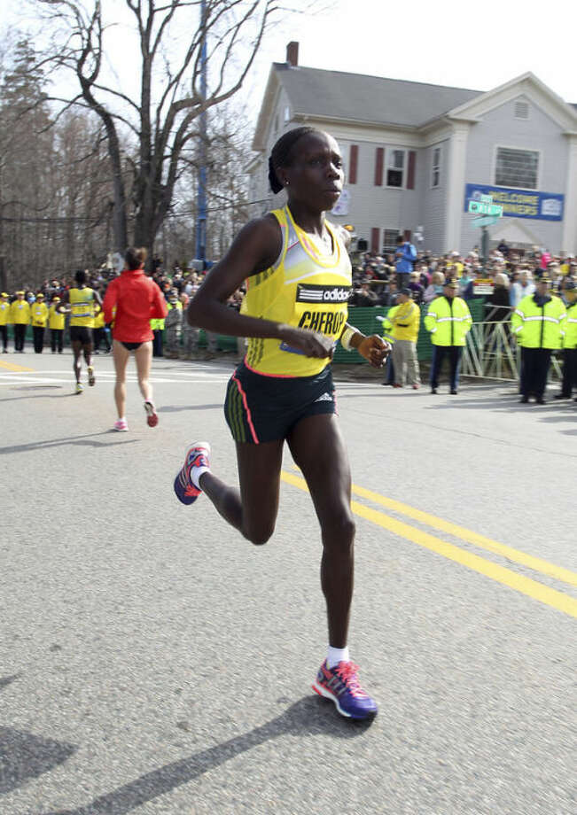 Defending champion Sharon Cherop, of Kenya, warms up prior to the start of the 117th running of the Boston Marathon, in Hopkinton, Mass., Monday, April 15, 2013. (AP Photo/Stew Milne)