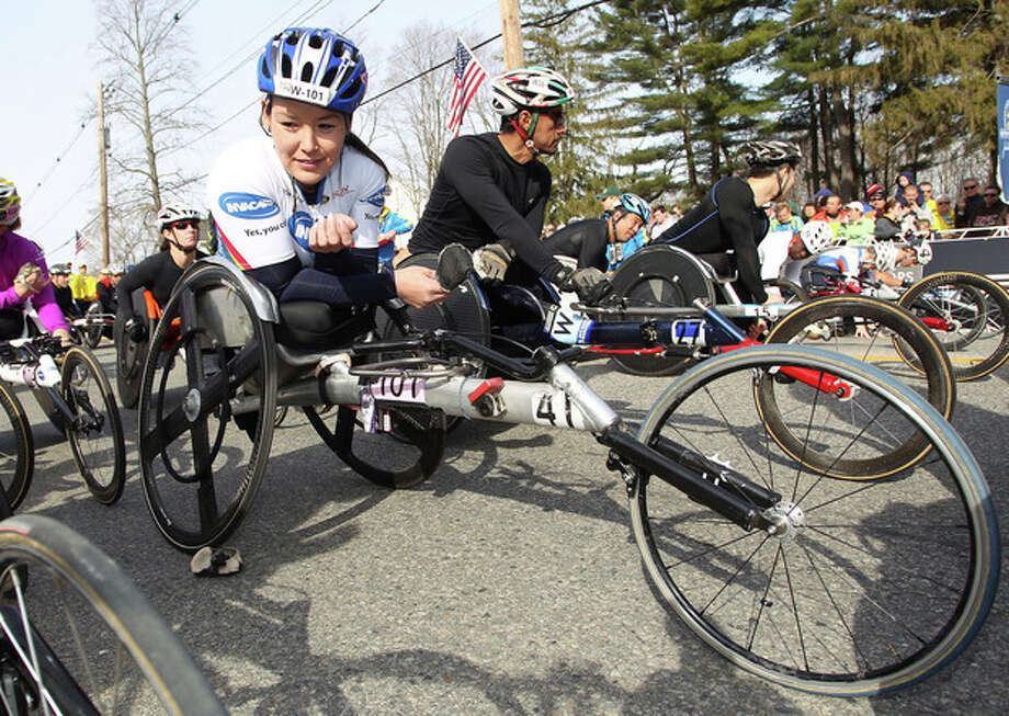 Defending champion Shirley Reilly, left, gets her wheelchair into position prior to the start of the wheelchair division of the 117th running of the Boston Marathon, in Hopkinton, Mass., Monday, April 15, 2013. (AP Photo/Stew Milne) / FR56276 AP