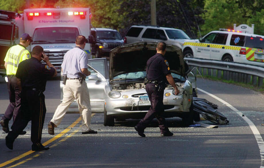 Wilton emergency personnel respond to the scene of a deadly accident on route 7 Tuesday morning. The road remained close for several hours after the accident. / (C)2011, The Hour Newspapers, all rights reserved