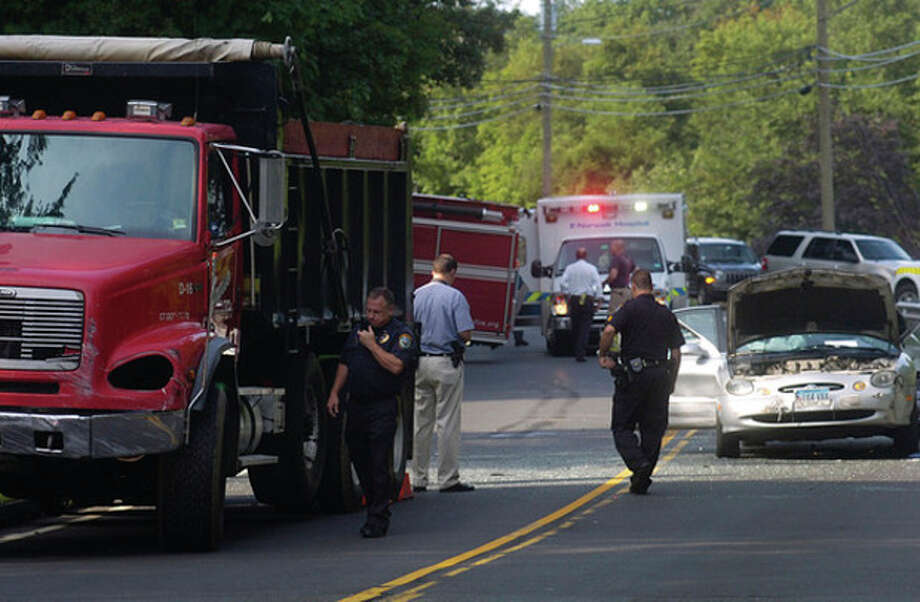 @White=[C] Hour photo / Erik Trautmann Wilton emergency personnel respond to the scene of a deadly accident on Route 7 Tuesday morning. / (C)2011, The Hour Newspapers, all rights reserved