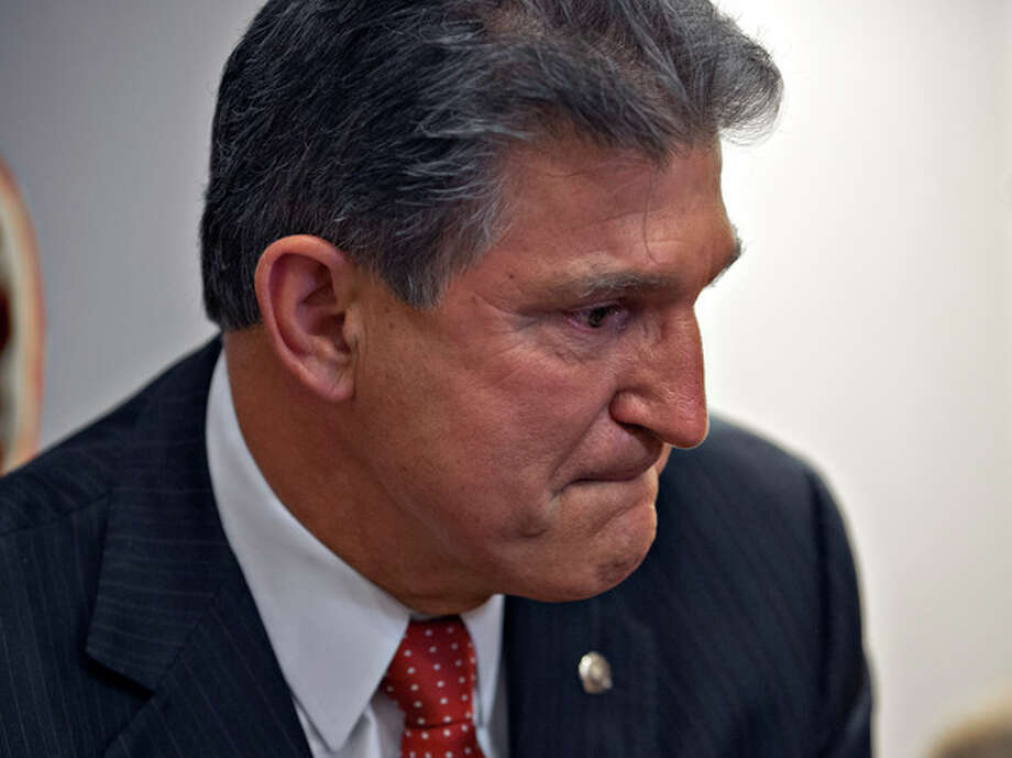 Sen. Joe Manchin, D-W.Va., becomes emotional as he meets in his office with families of victims of the Sandy Hook Elementary School shooting in Newtown, Conn., on the day he announced that they have reached reached a bipartisan deal on expanding background checks to more gun buyers, at the Capitol in Washington, Wednesday, April 10, 2013. (AP Photo/J. Scott Applewhite) / AP