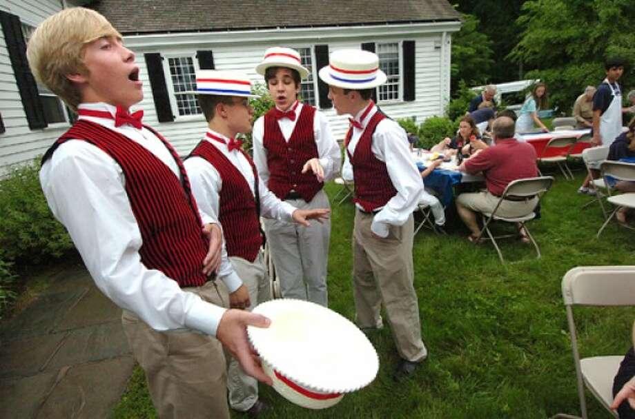Photo by Alex von Kleydorff. The Quartet of the High school play The Music Man serenade the Kiwanis Pancake breakfast in Wilton.