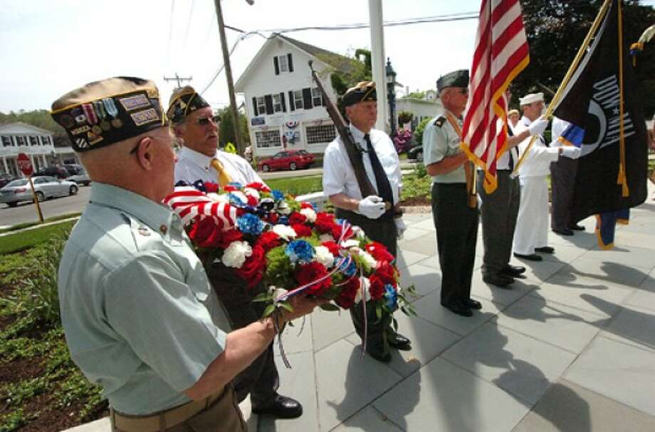 Photo by Alex von Kleydorff. American Legion Post 86 delivers a wreath to be laid on the Wilton Veterans Memorial in Wilton Center.