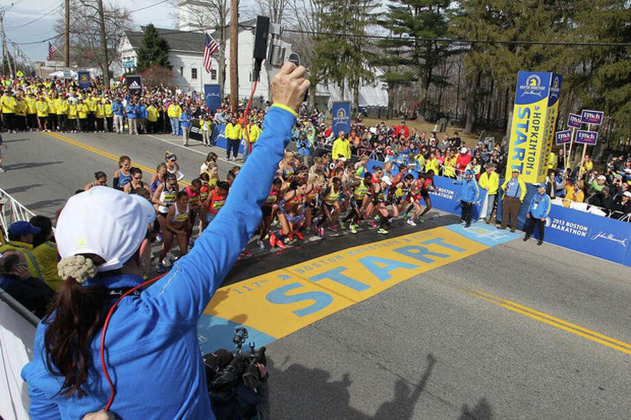 Jacqueline Benson shoots the starting piston for the elite womens start of the 117th running of the Boston Marathon, in Hopkinton, Mass., Monday, April 15, 2013. (AP Photo/Stew Milne) / FR56276 AP
