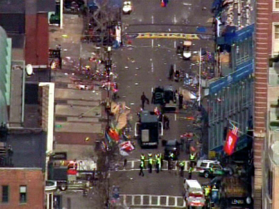 Medical workers and authorities work on the scene near the finish line of the 2013 Boston Marathon following an explosion in Boston, Monday, April 15, 2013. (AP Photo/WCVB-TV/ABC) MANDATORY CREDIT / WCVB-TV