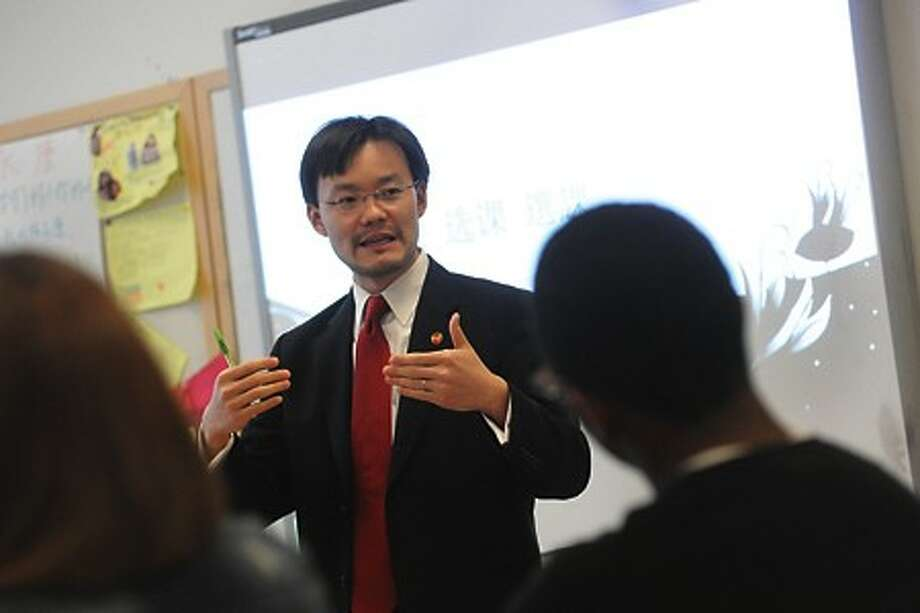 Jeff Wang, Assistant Director with Chinese Language Iniatives speaks to students at the Center For Global Sudies at Brien McMahon High School Thursday. The Center received a grant to expand it''s Chinese language program. hour photo/matthew vinci