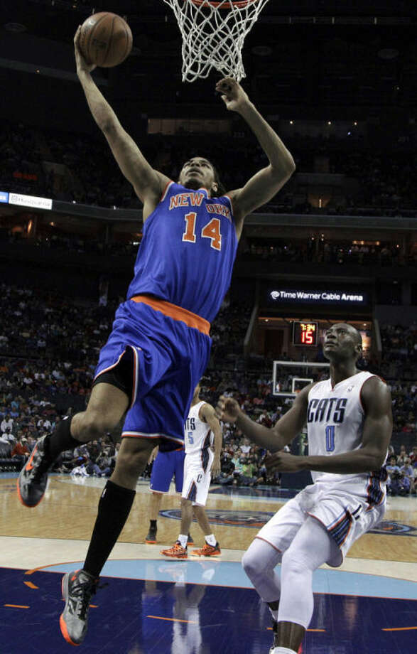 New York Knicks' Chris Copeland (14) drives past Charlotte Bobcats' Bismack Biyombo (0) during the first half of an NBA basketball game in Charlotte, N.C., Monday, April 15, 2013. (AP Photo/Chuck Burton)