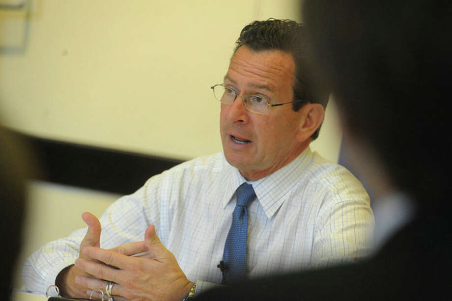 Connecticut Gov. Dannel P. Malloy speaks during a roundtable discussion at Stamford's Old Town Hallon Tuesday. photo/matthew vinci