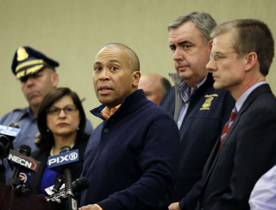 Massachusetts Gov. Deval Patrick speaks as Boston Police Commissioner Ed Davis, middle, and FBI Special Agent in Charge Richard DesLauriers, far right, listen at a news conference in Boston Monday, April 15, 2013 regarding two bombs which exploded in the street near the finish line of the Boston Marathon on Monday, killing three people and injuring more than 130. (AP Photo/Elise Amendola)