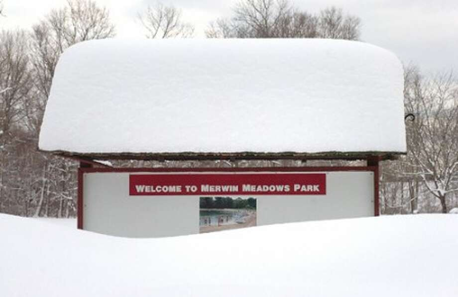 Photo/Alex von kleydorff. The sign at Merwin Meadows is almost covered by snow on Thursday morning.