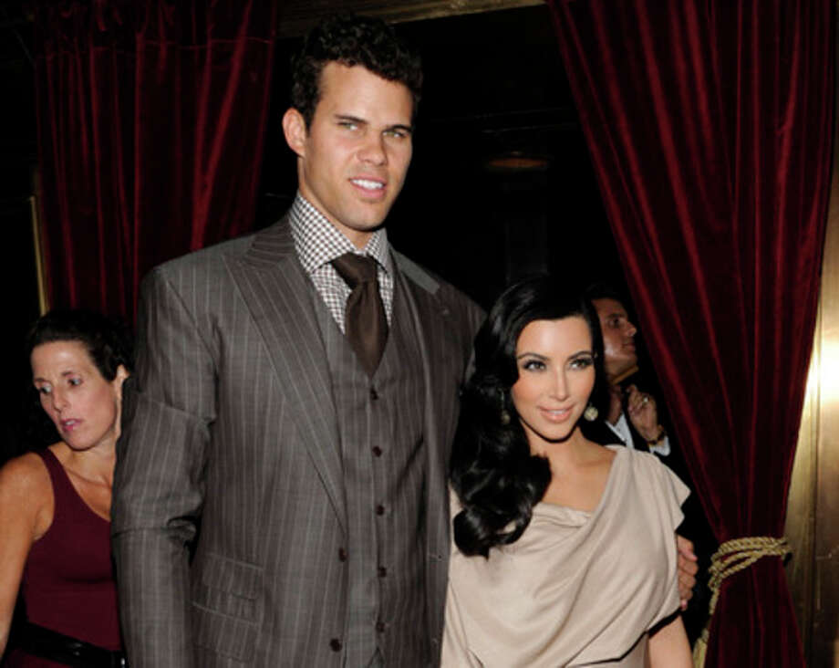 FILE - This Aug. 31, 2011 file photo shows newlyweds Kim Kardashian and Kris Humphries attending a party thrown in their honor at Capitale in New York. Kardashian appeared in a Los Angeles court on Friday April 12, 2013 for a mandatory settlement hearing in her divorce case from Humphries. Kardashian sat in the jury box before a judge called her case and sealed the hearing. (AP Photo/Evan Agostini, file) / AP