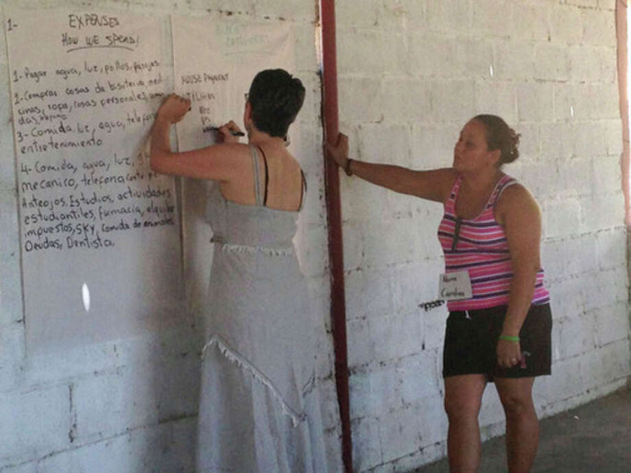 Contribed PhotoFran Pastore of Stamford-based WBDC, left, leads a financial literacy course in Costa Rica this winter.