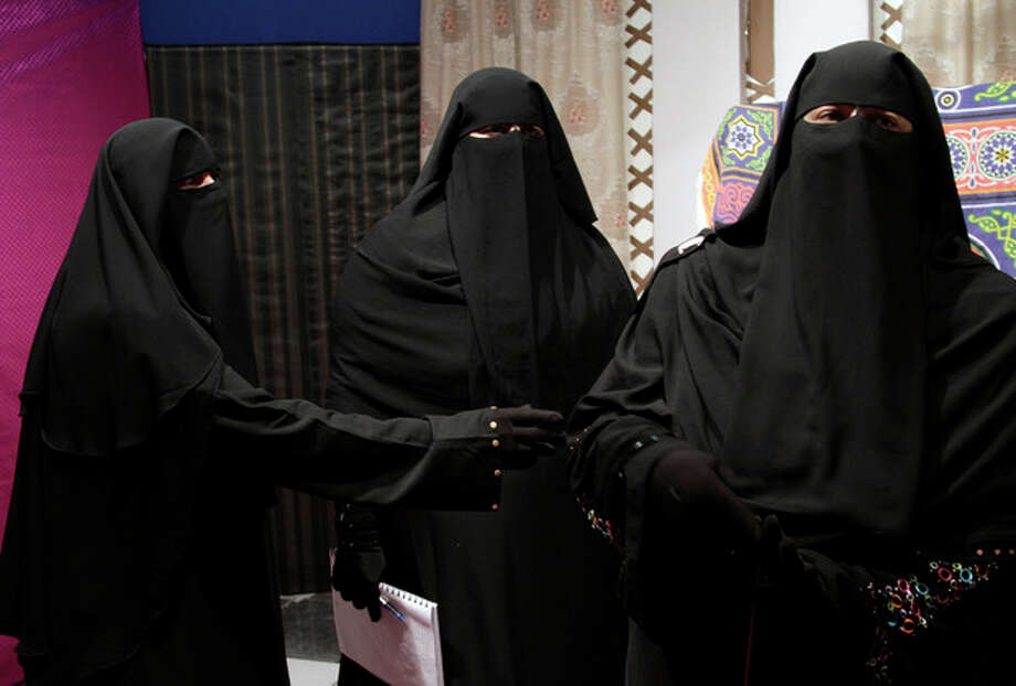 """Staff members of the Maria Channel prepare to film a segment of a Ramadan program at their studio in Cairo, Egypt, Monday, July 23, 2012. The first Egyptian satellite channel operated by women wearing the niqab, or face veil, launched on the first day of the holy month of Ramadan. The station manager says he hopesthe full face-veiled womenwill set anexample for othersby showing a """"new kind of woman"""" as a role model.(AP Photo/Maya Alleruzzo) / AP"""