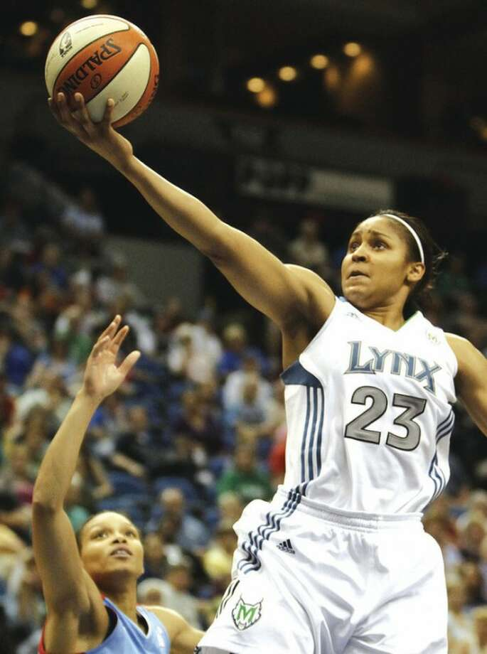FILE - This June 17, 2011, file photo shows Minnesota Lynx forward Maya Moore going to the basket in the second half of a WNBA basketball game against the Atlanta Dream, in Minneapolis. Rookie Maya Moore has the top-selling jersey in the WNBA this season. (AP Photo/Stacy Bengs, File)