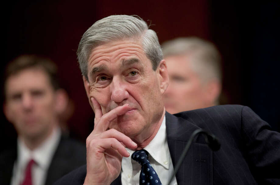 FBI Director Robert Mueller listens on Capitol Hill in Washington, Thursday, April 11, 2013, during the House Intelligence Committee hearing on worldwide threats. Mueller was among intelligence agency heads who testified before the committee. (AP Photo/Manuel Balce Ceneta) / AP