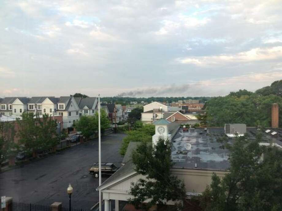 Contributed photohttps://twitter.com/FairfieldCty911 Smoke can be scene from the Norwalk Police Department as crews respond to a fire on Braybourne Drive Tuesday night.