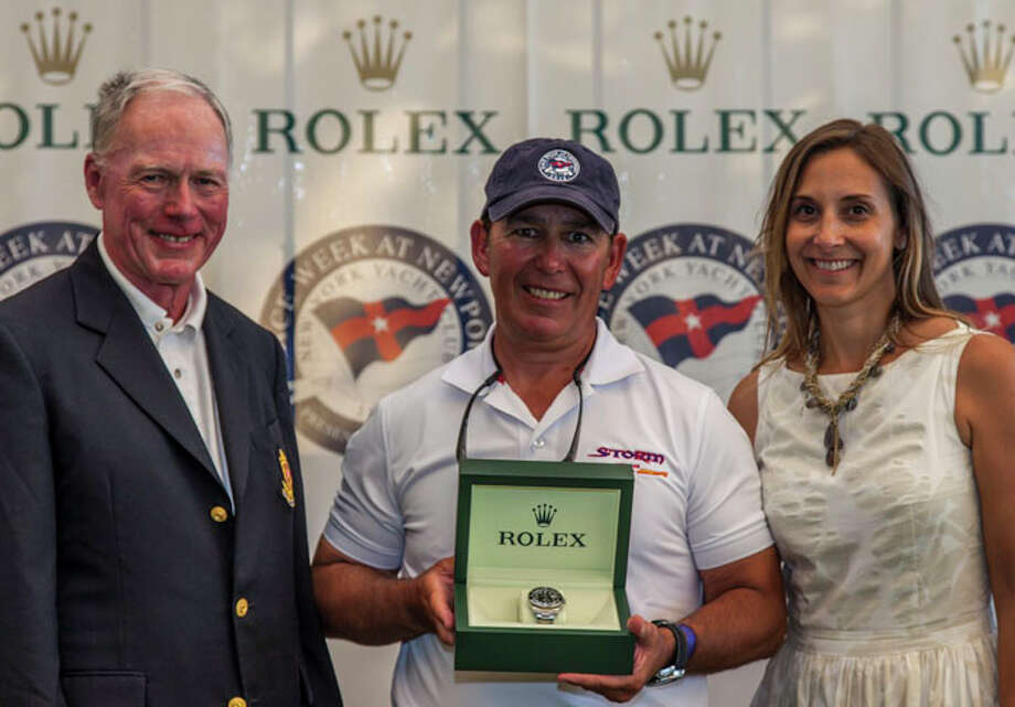 Rolex Watch U.S.A.'s Colette Bennett with Commodore Robert Towse and Rick Lyall owner of STORM, Class: J/109 Rolex Final Awards Ceremony / Protected by Copyright