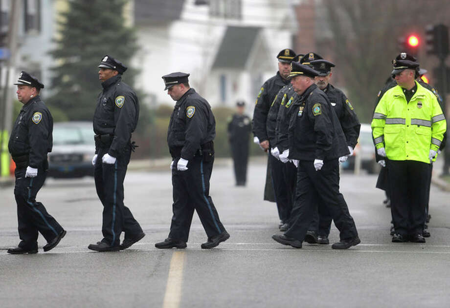 Police officers march in formation as they enter St. Patrick's Church, in Stoneham, Mass., before a funeral Mass for Massachusetts Institute of Technology police officer Sean Collier Tuesday, April 23, 2013. Collier was fatally shot on the MIT campus Thursday, April 18, 2013. Authorities allege that the Boston Marathon bombing suspects were responsible. (AP Photo/Steven Senne) / AP