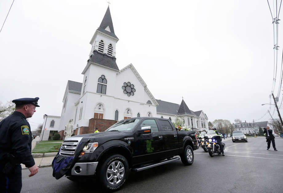 A truck that belonged to fallen Massachusetts Institute of Technology police officer Sean Collier is part of a funeral procession as it departs St. Patrick's Church in Stoneham, Mass., following a funeral Mass for Collier, Tuesday, April 23, 2013. Collier was fatally shot on the MIT campus Thursday, April 18, 2013. Authorities allege that the Boston Marathon bombing suspects were responsible. (AP Photo/Steven Senne) / AP