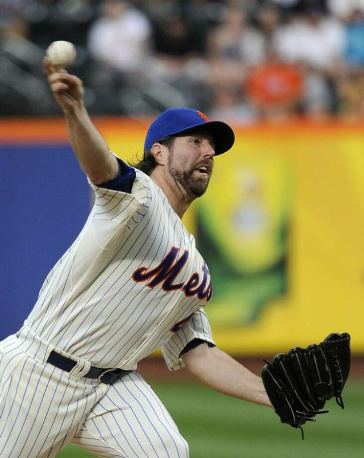 New York Mets starting pitcher R.A. Dickey (43) throws against the Washington Nationals in the first inning of a baseball game, Tuesday, July 24, 2012, at Citi Field in New York. (AP Photo/Kathy Kmonicek)