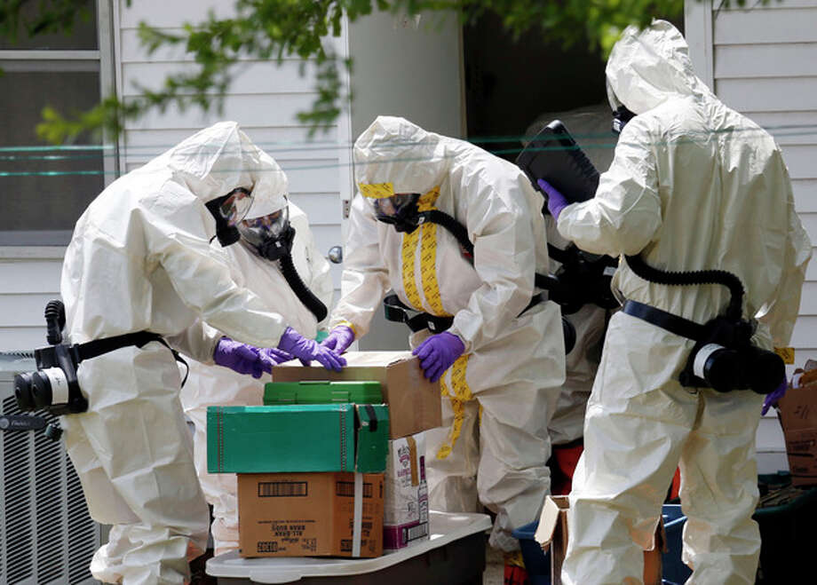 Federal agents wearing hazardous material suits and breathing apparatus inspect the home and possessions in the West Hills Subdivision house of Paul Kevin Curtis in Corinth, Miss., Friday, April 19, 2013. Curtis is in custody under the suspicion of sending letters covered in ricin to the U.S. President Barack Obama and U.S. Sen. Roger Wicker, R-Miss. (AP Photo/Rogelio V. Solis) / AP
