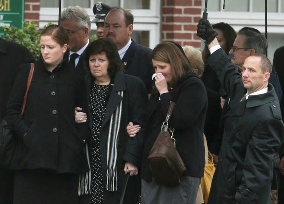 Mourners enter St. Patrick's Church in Stoneham, Mass., before a funeral Mass for Massachusetts Institute of Technology police officer Sean Collier, Tuesday, April 23, 2013. Collier was fatally shot on the MIT campus Thursday, April 18, 2013. Authorities allege that the Boston Marathon bombing suspects were responsible. (AP Photo/Steven Senne) / AP