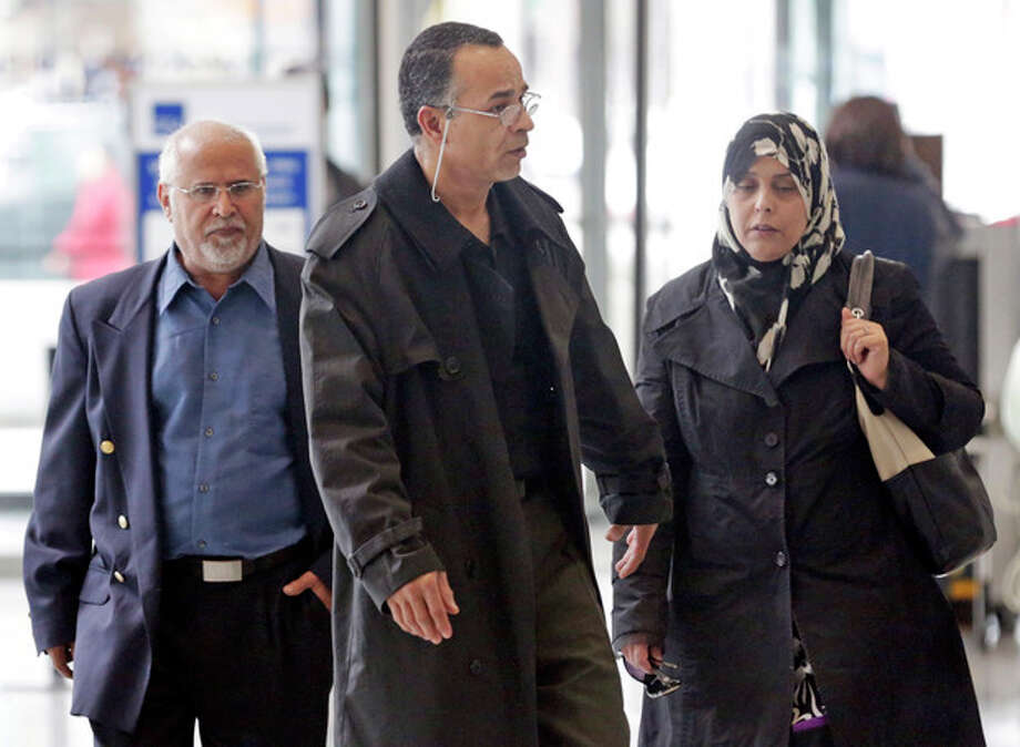 Family members of 18 year-old Abdella Ahmad Tounisi, including his father Ahmad Tounisi, center, leave the Dirksen Federal Building Tuesday, April 23, 2013, in Chicago after the Chicago-area teen, charged with trying to join an al-Qaida-affiliated group in Syria appeared in federal court. During the detention hearing, a federal judge said he'd delay a decision on bond until next week to give defense attorneys more time to prepare. (AP Photo/M. Spencer Green) / AP