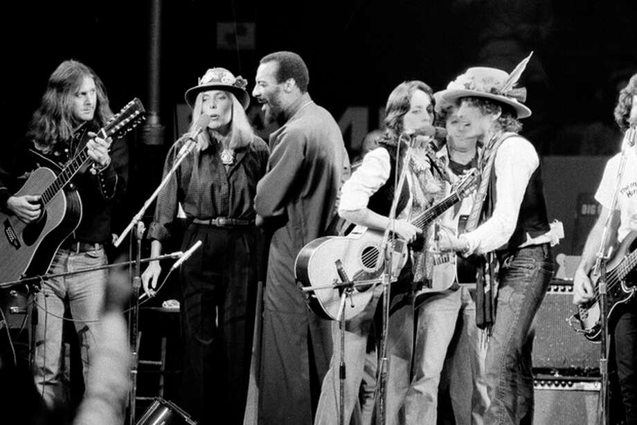 FILE - In this Dec. 1975 file photo, musicians Roger McGuinn, Joni Mitchell, Richie Havens, Joan Baez and Bob Dylan perform the finale of the The Rolling Thunder Revue, a tour headed by Dylan. Havens, who sang and strummed for a sea of people at Woodstock, has died at 72. His family says in a statement that Havens died Monday, April 22, 2013, of a heart attack. (AP Photo, File) / AP