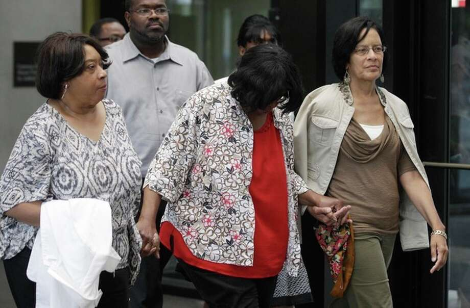 Supporters of Jennifer Hudson leave the criminal courts building after a Cook County judge convicted William Balfour to three life sentences plus 120 years for the murders of the mother, brother and nephew of Grammy and Oscar award winner Jennifer Hudson, Tuesday, July 24, 2012, in Chicago. The sentencing came after Circuit Judge Charles Burns denied a request from Balfour for a new trial. Balfour faced a mandatory life sentence. Illinois does not have the death penalty. (AP Photo/M. Spencer Green) / AP