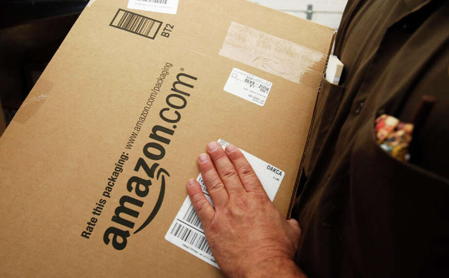 FILE - In this Oct. 18, 2010 file photo, an Amazon.com package is prepared for shipment by a United Parcel Service (UPS) driver in Palo Alto, Calif. States could force Internet retailers to collect sales taxes under a bill that overwhelmingly passed a test vote in the Senate Monday, April 22, 2013. (AP Photo/Paul Sakuma, File) / AP