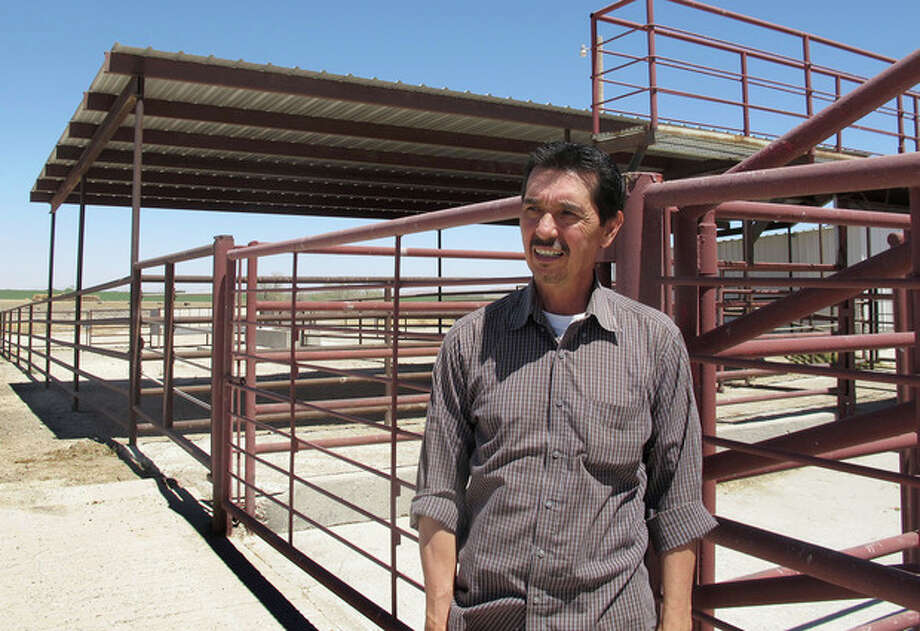 Valley Meat Co. owner Rick De Los Santos stands in a corral area outside the former cattle slaughterhouse he has converted to a horse slaughter facility in Roswell, N.M., Monday, April 15, 2013. The plant --- which has been waiting more than a year for federal approval of its operations -- has become ground zero for an emotional, national debate over a return to domestic horse slaughter. (AP Photo/Jeri Clausing) / AP