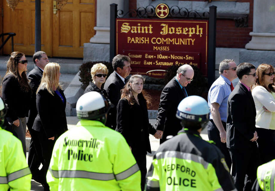 Mourners file into St. Joseph's Church in Medford, Mass. Monday, April 22, 2013 for the funeral of Boston Marathon bomb victim Krystle Campbell, 29. (AP Photo/Elise Amendola) / AP