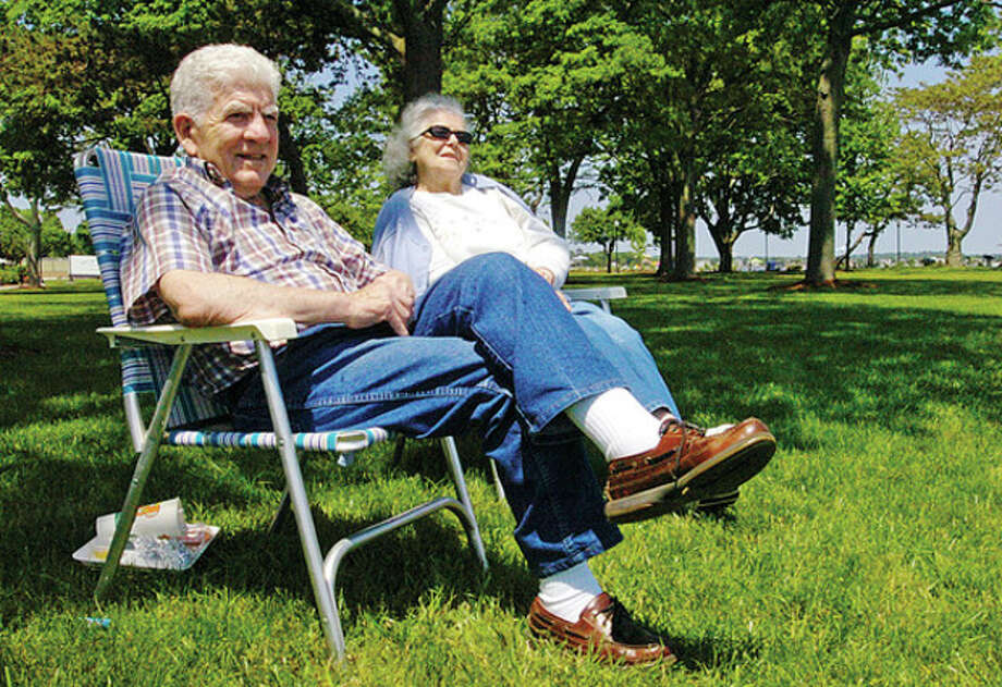 Norwalkers Anthony and Nan Conte enjoy the beautiful weather Tuesday at Calf Pasture Beach. Hour photo / Erik Trautmann / (C)2011, The Hour Newspapers, all rights reserved