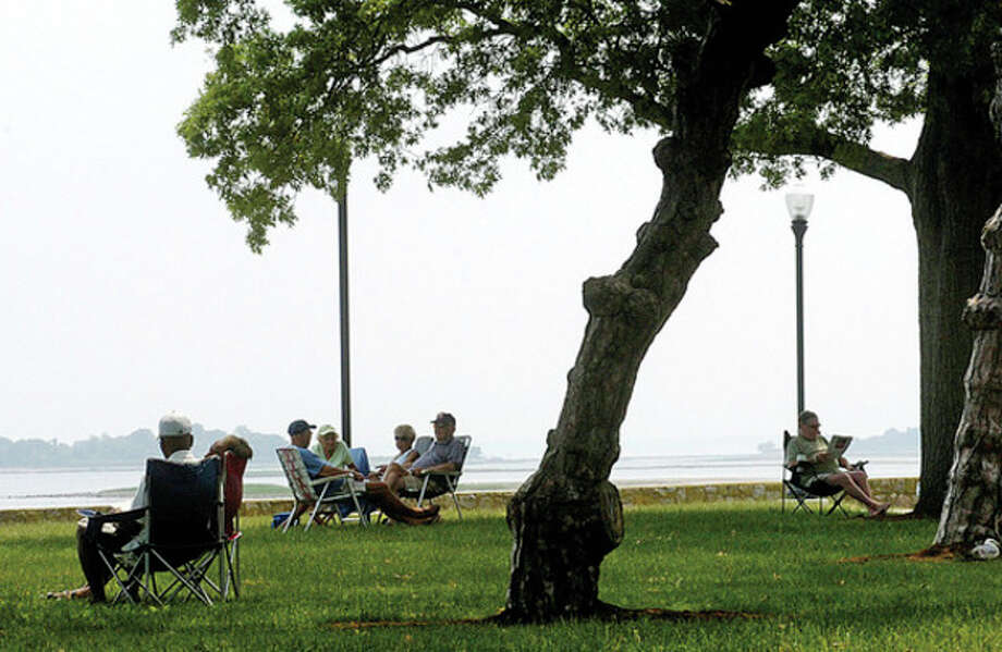 Residents line up in the shade at Calf Pasture Beach Thursday. Temperatures reached into the 90s with high humidity. Schools let out early and an air quality alert was issued. Hour photo / Erik Trautmann / (C)2011, The Hour Newspapers, all rights reserved