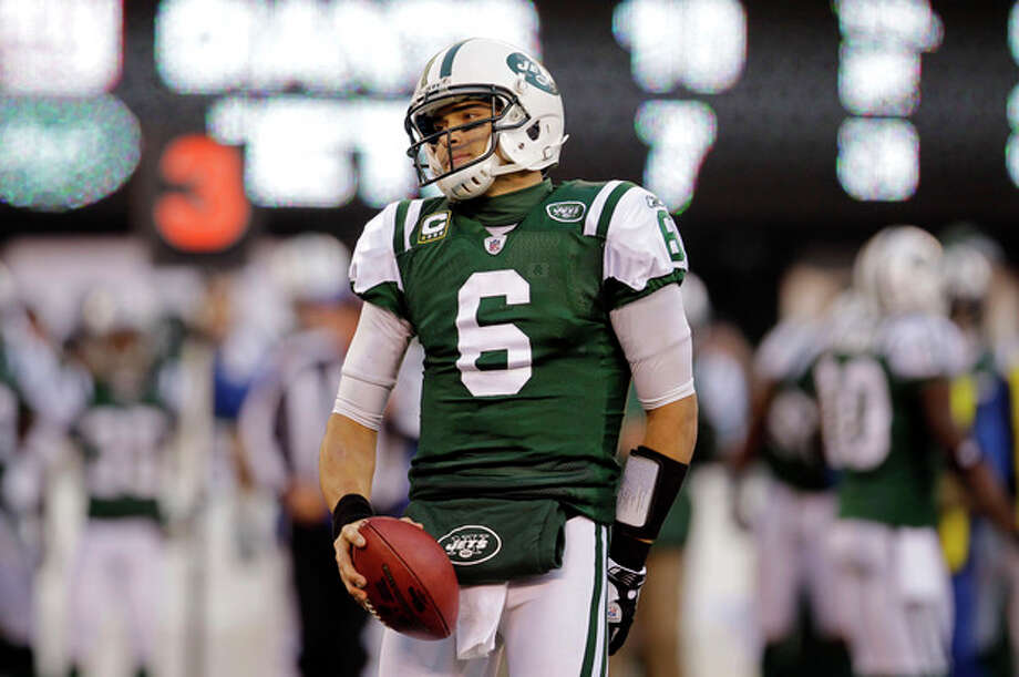 New York Jets quarterback Mark Sanchez reacts during the third quarter of an NFL football game against the New York Giants Saturday, Dec. 24, 2011, in East Rutherford, N.J. (AP Photo/Julio Cortez) / AP