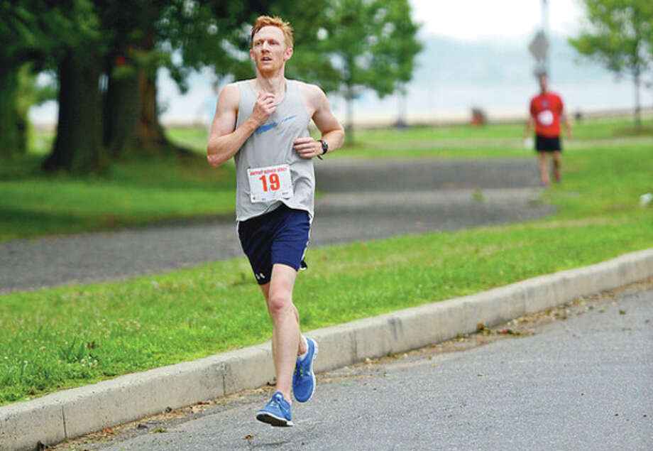 Joe Lauer finishes second at the 14th Annual Ian James Eaccarino Memorial 9-Mile Race at Calf Pasture Beach Saturday.Hour photo / Erik Trautmann / (C)2012, The Hour Newspapers, all rights reserved