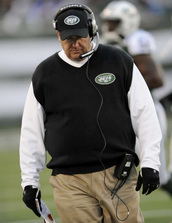 New York Jets head coach Rex Ryan walks on the sidelines during the third quarter of an NFL football game against the New York Giants, Saturday, Dec. 24, 2011, in East Rutherford, N.J. (AP Photo/Bill Kostroun)