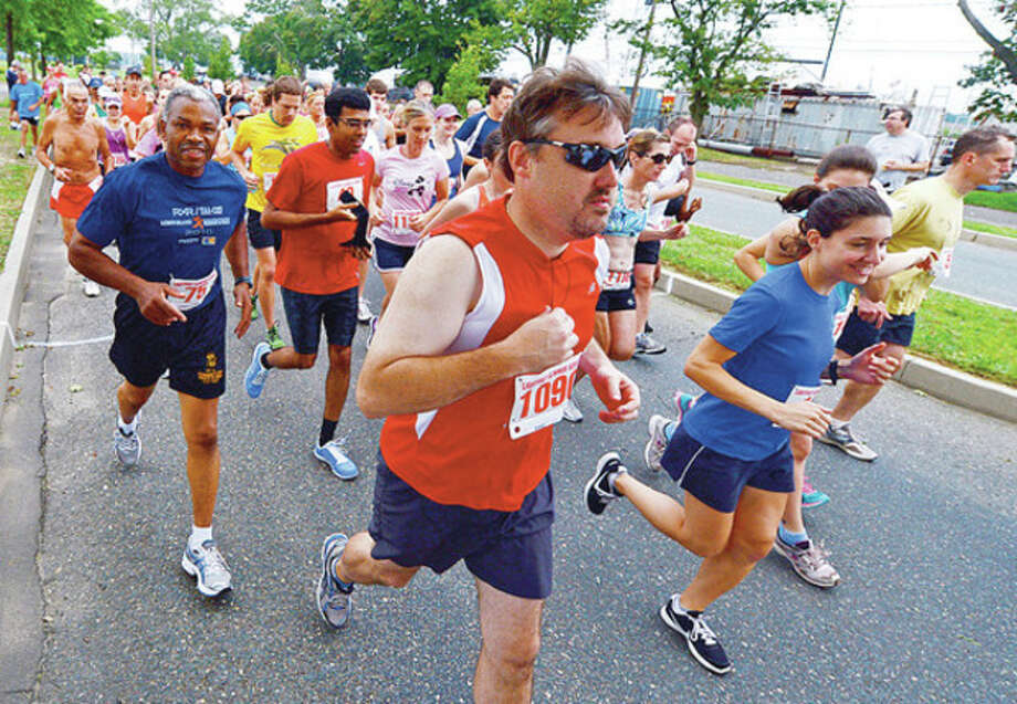 Runners start out at the 14th Annual Ian James Eaccarino Memorial 9-Mile Race at Calf Pasture Beach Saturday.Hour photo / Erik Trautmann / (C)2012, The Hour Newspapers, all rights reserved