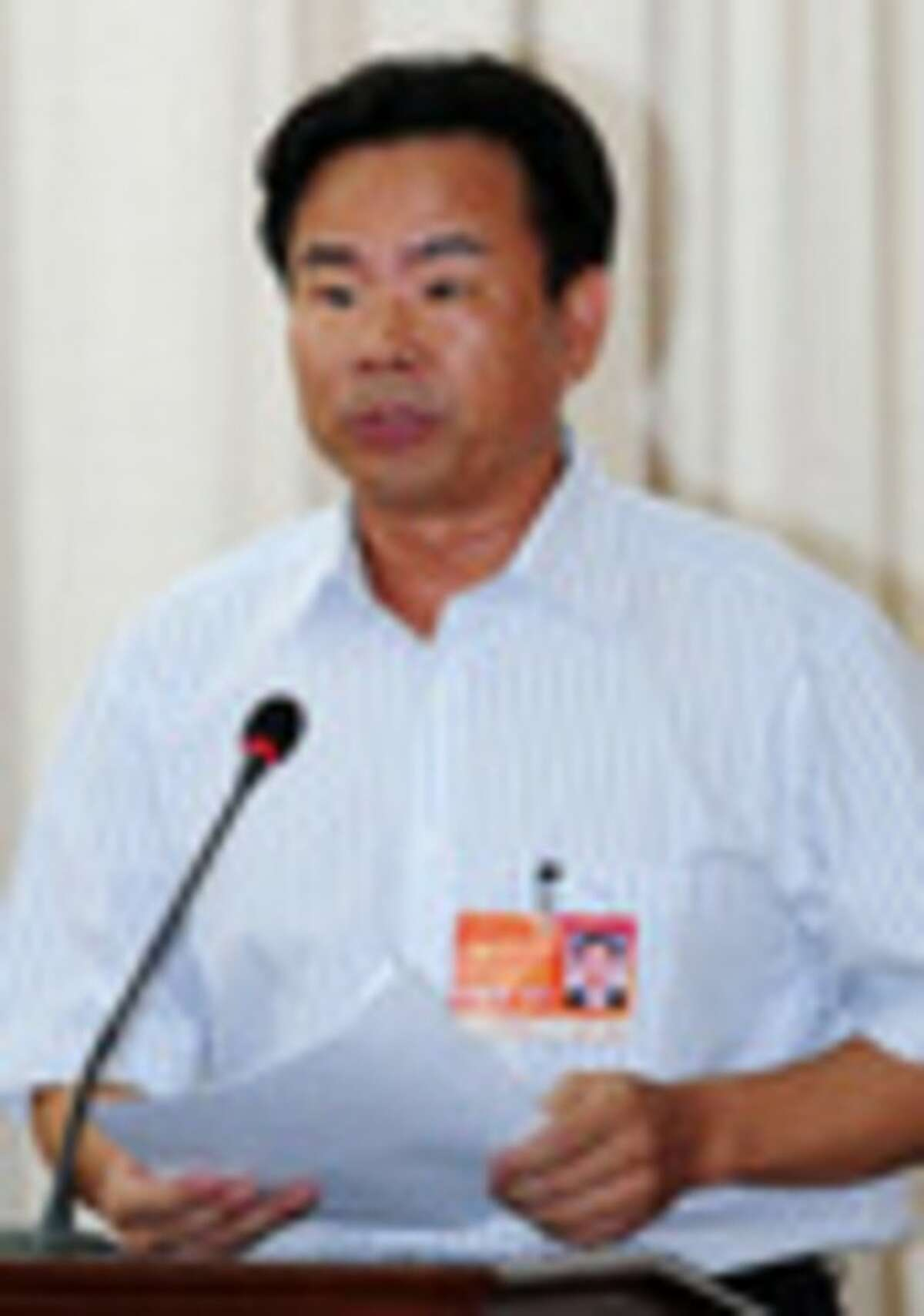 In this Monday, July 23, 2012 photo released by China's Xinhua News Agency, Xiao Jie, the first mayor of the newly established Sansha city, speaks in the first session of the first Sansha Municipal People's Congress held on Yongxing Island in south China's Hainan province. China has rolled out the red carpet for its newest city, on a small, remote island in the South China Sea that is also claimed by Vietnam. Beijing on Tuesday, July 24, formally established the city of Sansha to bolster its claim on the sea's oil and gas-rich waters. The move is likely to anger China's neighbors and competing claimants in a dispute that has at times led to maritime standoffs. (AP Photo/Xinhua, Hou Jiansen) NO SALES