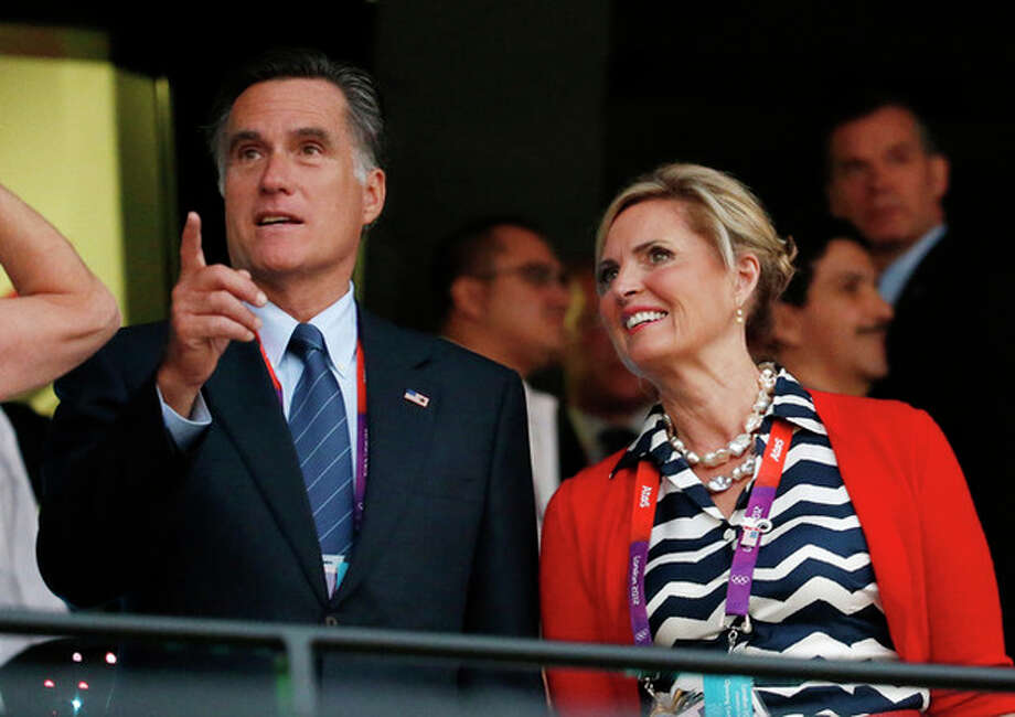 U.S. Republican Presidential candidate Mitt Romney, left, and his wife Ann arrive for the Opening Ceremony at the 2012 Summer Olympics, Friday, July 27, 2012, in London. (AP Photo/Jae C. Hong) / AP