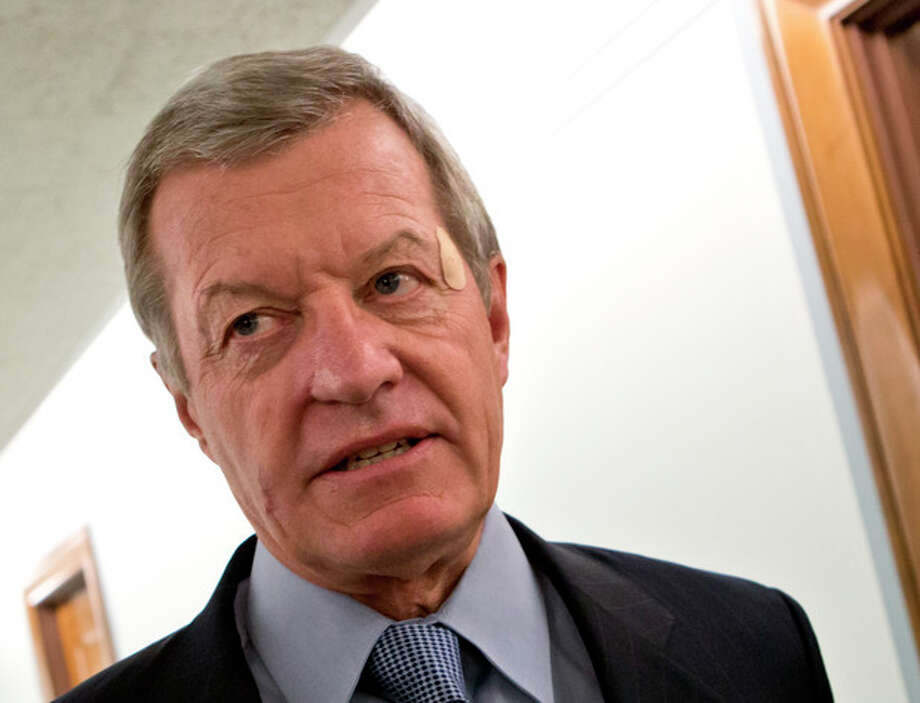 FILE - In this Sept. 19, 2012 file photo, Senate Finance Committee Chairman Max Baucus, D-Mont. speaks reporters on Capitol Hill in Washington. According to Democratic officials: The six-term Democratic Sen. Max Baucus plans to retire. (AP Photo/J. Scott Applewhite, File) / AP
