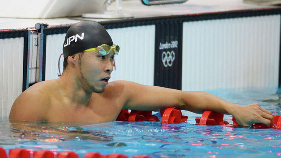 Japan's Kosuke Kitajima reacts after swimming a men's 100-meter breaststroke heat at the Aquatics Centre in the Olympic Park during the 2012 Summer Olympics in London, Saturday, July 28, 2012. (AP Photo/Mark J. Terrill) / AP