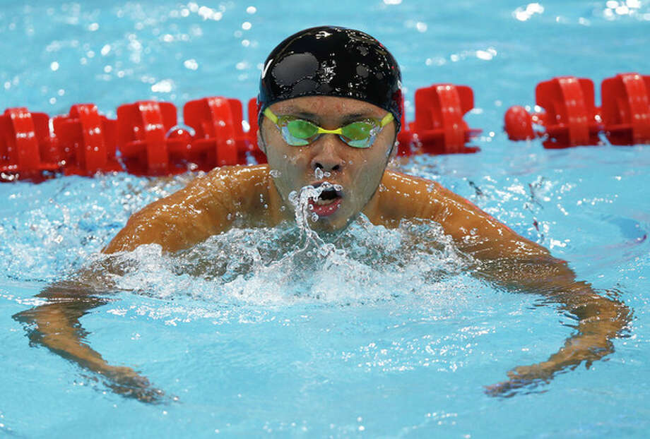 Japan's Kosuke Kitajima reacts after competing in a heat of the men's 100-meter breaststroke at the Aquatics Centre in the Olympic Park during the 2012 Summer Olympics in London, Saturday, July 28, 2012. (AP Photo/Daniel Ochoa De Olza) / AP