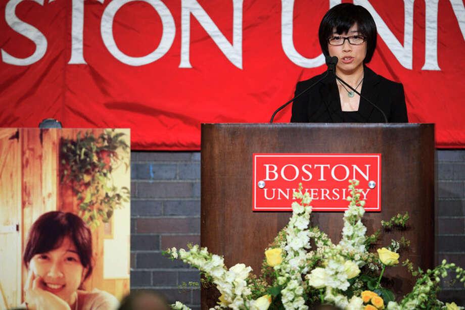 Zheng Minhui a classmate of Lu Lingzi, speaks of Lingzi during her memorial service at Metcalf Hall in Boston University's George Sherman Student Union on Monday, April 22, 2013. Lingzi was killed in the Boston Marathon bombings. (AP Photo/The Boston Globe, Dina Rudick, Pool) / POOL The Boston Globe
