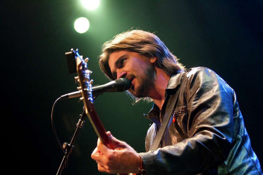 Colombian singer Juanes warms up during a sound check before his concert in Washington, Thursday, July 26, 2012. (AP Photo/Jacquelyn Martin) / AP