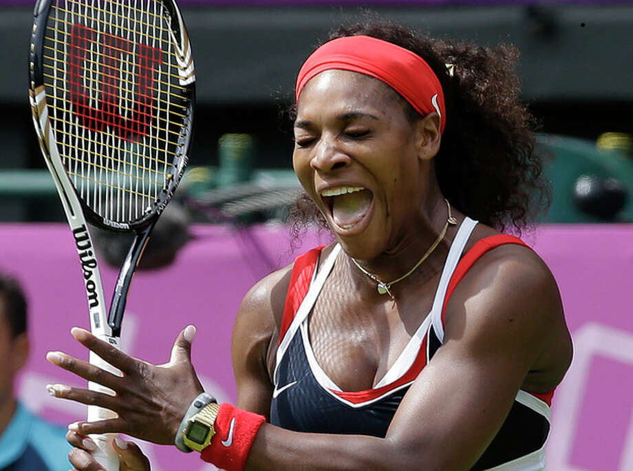 Serena Williams of the United States screams as she competes against Jelena Jankovic of Serbia during a first round match at the All England Lawn Tennis Club in Wimbledon, London at the 2012 Summer Olympics, Saturday, July 28, 2012. (AP Photo/Elise Amendola) / AP