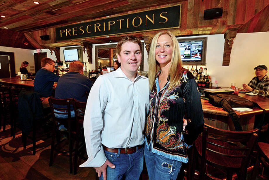 Co-owner of Little Pub, Daneen Grabe and her manager Lars Andersen. Hour photo / Erik Trautmann / (C)2013, The Hour Newspapers, all rights reserved